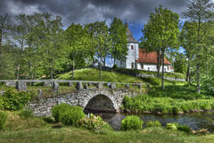 Old church and stone bridge in Sweden Royalty Free Stock Images