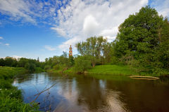 Old church and summer river Stock Photography