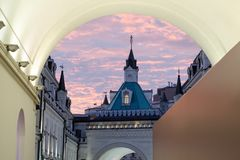 Old church at sunset through the arch. Royalty Free Stock Photography