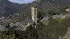 Old church on top of a mountain - Engolasters, Andorra - Pyrenees. Views of all the valley with Andorra La Vella on bottom. Ancient church of Engolasters on top stock footage