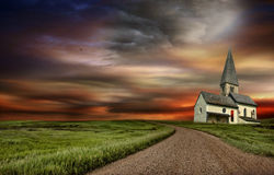 The old church at the top of the road. A Old derelict church at the top of the road  with stormy sky Royalty Free Stock Image