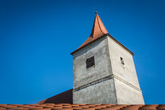 Old church tower and blue sky.  stock images