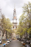 Old church tower and canal in Amsterdam Royalty Free Stock Photography
