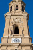 Old church tower with a clock on a background of blue sky Stock Image