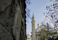 Old church tower with a minaret close together. Old church tower with a minaret close Royalty Free Stock Photos