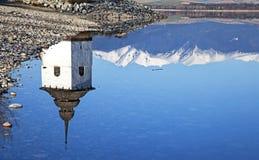 Old church tower near water basin Liptovska Mara Royalty Free Stock Image