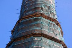 Old church tower under renovation. Novodevichy convent in Moscow Royalty Free Stock Photo