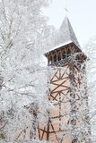 Old church tower and winter trees, Stary Smokovec - Slovakia Stock Images