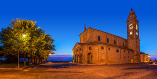 Old church on town square at evening. Royalty Free Stock Images
