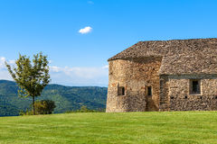 Old church and tree in Piedmont, Italy. Stock Image