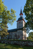 Old church with trees Royalty Free Stock Photos