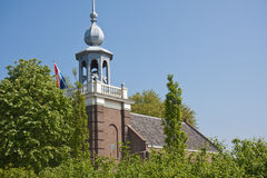 Old church with tricolor. Old church in the Netherlands with Dutch flag stock image