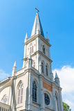 Old church turret in neoclassical style. With stained-glass window under blue sky stock photos
