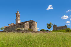 Old church under blue sky in Piedmont, Italy. Royalty Free Stock Image