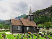Old church in the valley Fl�msdalen, Norway. Church is located in a beautiful intermontane valley near the river, among picturesque houses. In the territory Royalty Free Stock Photography