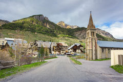 Old church in village Cervieres Stock Photography