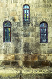 Old church wall with three windows. Stock Images