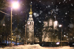Old church in winter at night Stock Photography