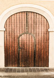 Old church wood textured door with stone arch Royalty Free Stock Images