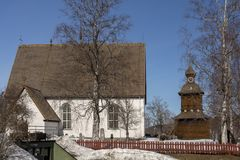 Old church and wooden belfry against blue sky Stock Image