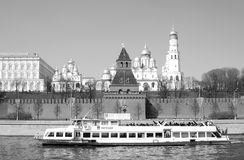 Old churches of Moscow Kremlin. Cruise ship sails on the Moscow river. Royalty Free Stock Photography