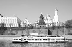 Old churches of Moscow Kremlin. Cruise ship sails on the Moscow river. Royalty Free Stock Photos