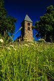 Old churchtower - 13th century church Royalty Free Stock Images