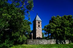 Old churchtower - 13th century church Royalty Free Stock Photo