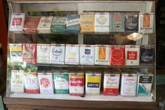 Old cigarettes are a collection of presents in a glass cabinet royalty free stock images