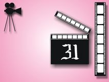 Old cinecamera and film strip. Pink background with black camera shape and film strip Stock Photo