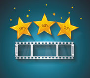 Old Cinema banner with gold stars and film tape. Royalty Free Stock Images