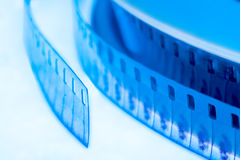 Old cinema film 16 mm. In blue Royalty Free Stock Photo
