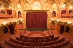Old cinema interiors. Gold and velvet decorations Stock Images