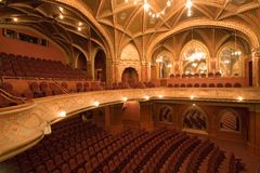 Old cinema interiors. Gold and velvet decorations Royalty Free Stock Photography