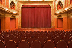Old cinema interiors. Gold and velvet decorations Royalty Free Stock Images
