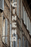 Old cinema signboard. In a street of Urbino city, in Italy stock photography