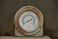 Old circle thermometer. Old circle thermometer in factory Stock Image