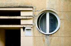 Old circle windows frame on cement cracked wall Royalty Free Stock Photography