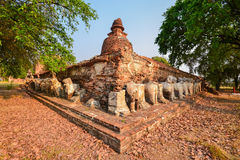 Old circular pagoda on square base. Surround with animal sculpture Royalty Free Stock Photo