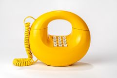 Old Circular Retro Telephone, one piece rotary dial on bottom royalty free stock images