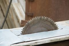 Old Circular saw. Carpentry. Background of wood and rusty iron Stock Photo
