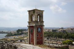 Old citadel in Corfu Town (Greece). Clock tower of Old citadel (Palaio Frourio in Greek) in Corfu Town (Greece). It is an old Venetian fortress built on an Stock Image