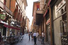 Street life Bologna. Old city of Bologna, Italy, with arcades, shops and restaurants Royalty Free Stock Photography