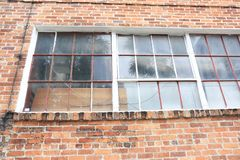 Old City Brick Warehouse with Vintage Windows royalty free stock images