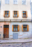 Old city building with shuttered windows Stock Images