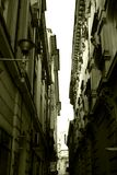 Old city buildings. Narrow street between two old buildings Royalty Free Stock Photos