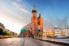 Old city center view with Adam Mickiewicz monument and St. Mary' Stock Photo