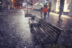 Old city at Christmas night. Bench winter street in old city at Christmas night Stock Image