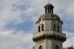 Old city clock tower on a cloudy sky background royalty free stock photography
