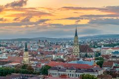The old city of Cluj-Napoca with the Franciscan Church and St. Michael& x27;s Church viewed from Cetatuia Park at sunrise in Cluj- royalty free stock photography